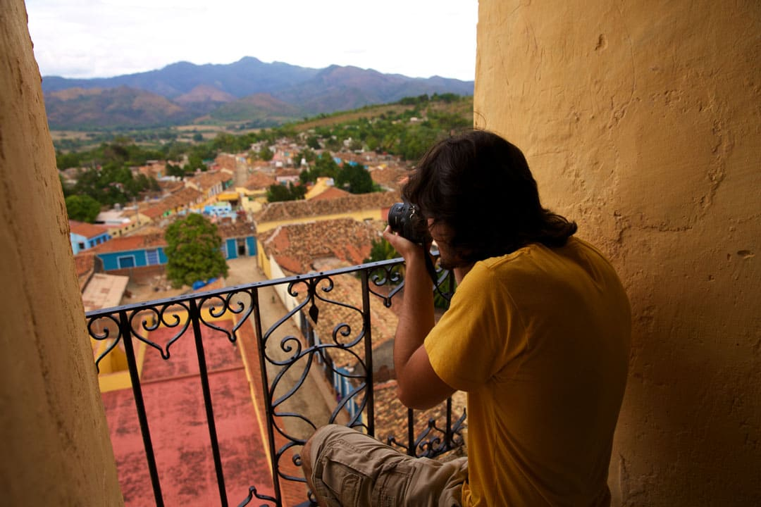 Shooting photos from a balcony in a village
