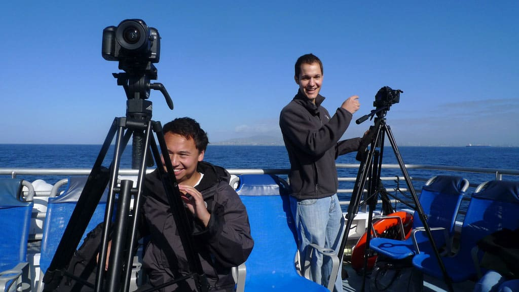 Wildlife boys on a boat with DSLRs